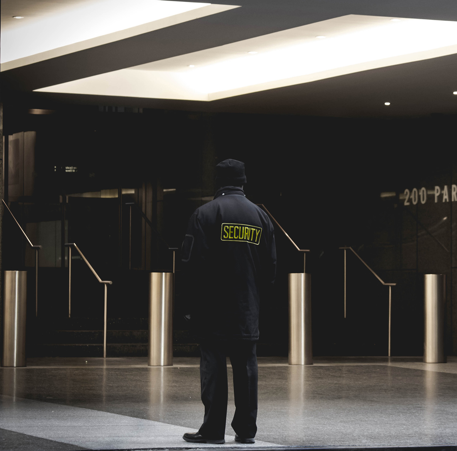 Security guarding main entrance of building